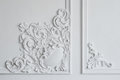 White wall molding with geometric shape and vanishing point. Luxury white wall design bas-relief with stucco mouldings