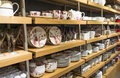 White ware variety of decorated porcelain in the wooden shelves Royalty Free Stock Photography