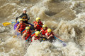 White water rafting a group of men and women with a guide on the patate river ecuador Royalty Free Stock Photography
