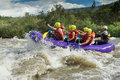 White water rafting a group of men and women with a guide on the patate river ecuador Royalty Free Stock Photos