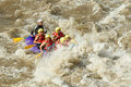 White water rafting a group of men and women with a guide on the patate river ecuador Stock Photo