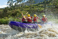 White water rafting a group of men and women with a guide on the patate river ecuador Royalty Free Stock Image