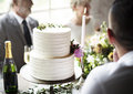 White Wedding Cake with Champagne Bottle Royalty Free Stock Photo