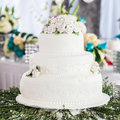 White wedding cake tier with flowers Stock Images