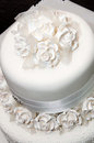 White wedding cake white ribbon fondant flowers royal icing Stock Photography