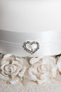 White wedding cake white ribbon heart jewellery fondant flowers royal icing Stock Photos