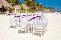 White wedding chairs decorated with purple bows on sandy beach see my other works in portfolio Stock Photo