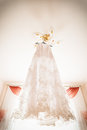 White wedding dress hanging on a shoulders Stock Photos
