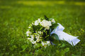 White wedding flowers on the green grass beautiful bouquet Stock Photo