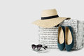 White wicker suitcase, womens hat, sunglasses, blue shoes and e- Royalty Free Stock Photo