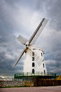 White windmill under dramatic sky blennerville ireland Stock Image
