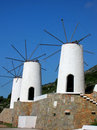 White windmills on the island Crete in Greece Stock Photo
