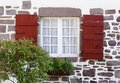 White window and red shutters Royalty Free Stock Images