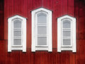 White windows on an old red church wall three wooden of th century scandinavian Royalty Free Stock Photo