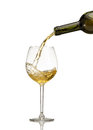 White wine being poured into wine glass Royalty Free Stock Photo