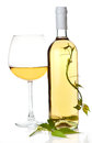 White wine bottle and glass. Stock Photos