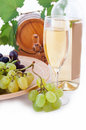 White wine bottle, glass and cask with grapes Royalty Free Stock Photos