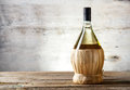 White wine bottle on old wooden table Royalty Free Stock Photos
