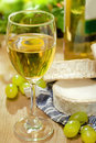 White wine, Brie and Camembert cheeses and grape Royalty Free Stock Photo