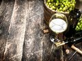 White wine with a bucket of green grapes. Royalty Free Stock Photo