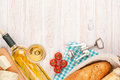 White wine, cheese and bread on white wooden table background Royalty Free Stock Photo