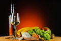 White wine cheese and fruits still life with Royalty Free Stock Image