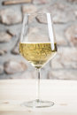 White wine glass in restaurant with copy space for text Stock Photography