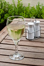 White Wine In Glass On Restaurant Table Royalty Free Stock Photo