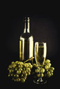 White wine and grapes in bottle glass on dark background Royalty Free Stock Photo