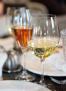 White wine and pink champagne on table restaurant Royalty Free Stock Photo