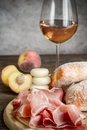 White wine with prosciutto and ciabatta Royalty Free Stock Photo