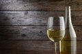 White wine and rustic wooden background