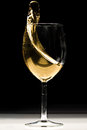 White wine splash splashing on black background Stock Photography