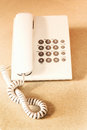 Top view or flat lay of digital voip black telephone on white ta