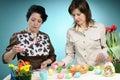White women arranging easter eggs Royalty Free Stock Image
