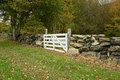 White wood gate by a stonewall in the rural countryside in connecticut Royalty Free Stock Images