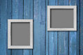 White wood picture frame on Blue wall Stock Image