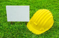 White wood sign and Safety helmet Stock Photos