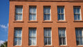 Windows in Old Red Stucco Building Royalty Free Stock Photo