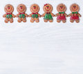 White wooden boards with Christmas cookies on upper border Royalty Free Stock Photo