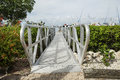 White wooden footbridge leads from the marina to the mainland fort myers florida Stock Image