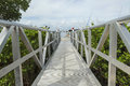 White wooden footbridge leads from the marina to the mainland fort myers florida Royalty Free Stock Images