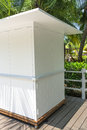 White wooden kiosk with tropical palm tree Royalty Free Stock Image