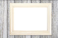 White wooden picture frame on wood wall Royalty Free Stock Photo