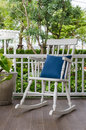 White wooden rocking chair on front porch Royalty Free Stock Photo