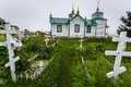White wooden russian orthodox church in alaska rural with onion shaped decorations Royalty Free Stock Image