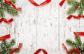 White wooden table with Christmas decoration. Top view of table with christmas tree and decorative strips Royalty Free Stock Photo