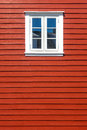 White wooden window on the red wooden house wall traditional norway with copy space Royalty Free Stock Photo
