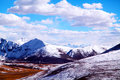 White world snow moutain and clouds in tibet Stock Photos