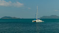 The white yacht-catamaran in the sea Royalty Free Stock Photo